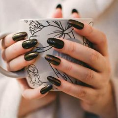 Woman With Manicure Holding Floral Ceramic Cup