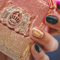 Woman with Nice Manicure Holding Glitter-Covered Perfume Bottle