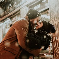 Young Couple in Love, Kissing in the Snowfall