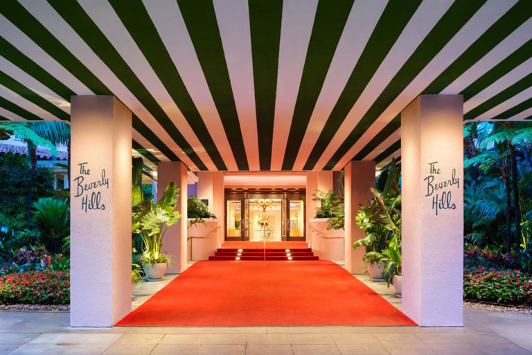 Grand entrance of the Beverly Hills Hotel showing the red carpet leading to the front doors